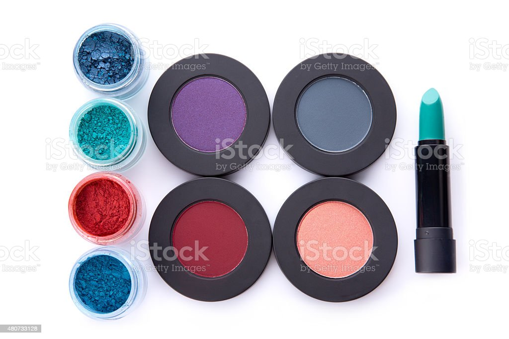 Set of loose and pressed eyeshadows, and lipstick stock photo