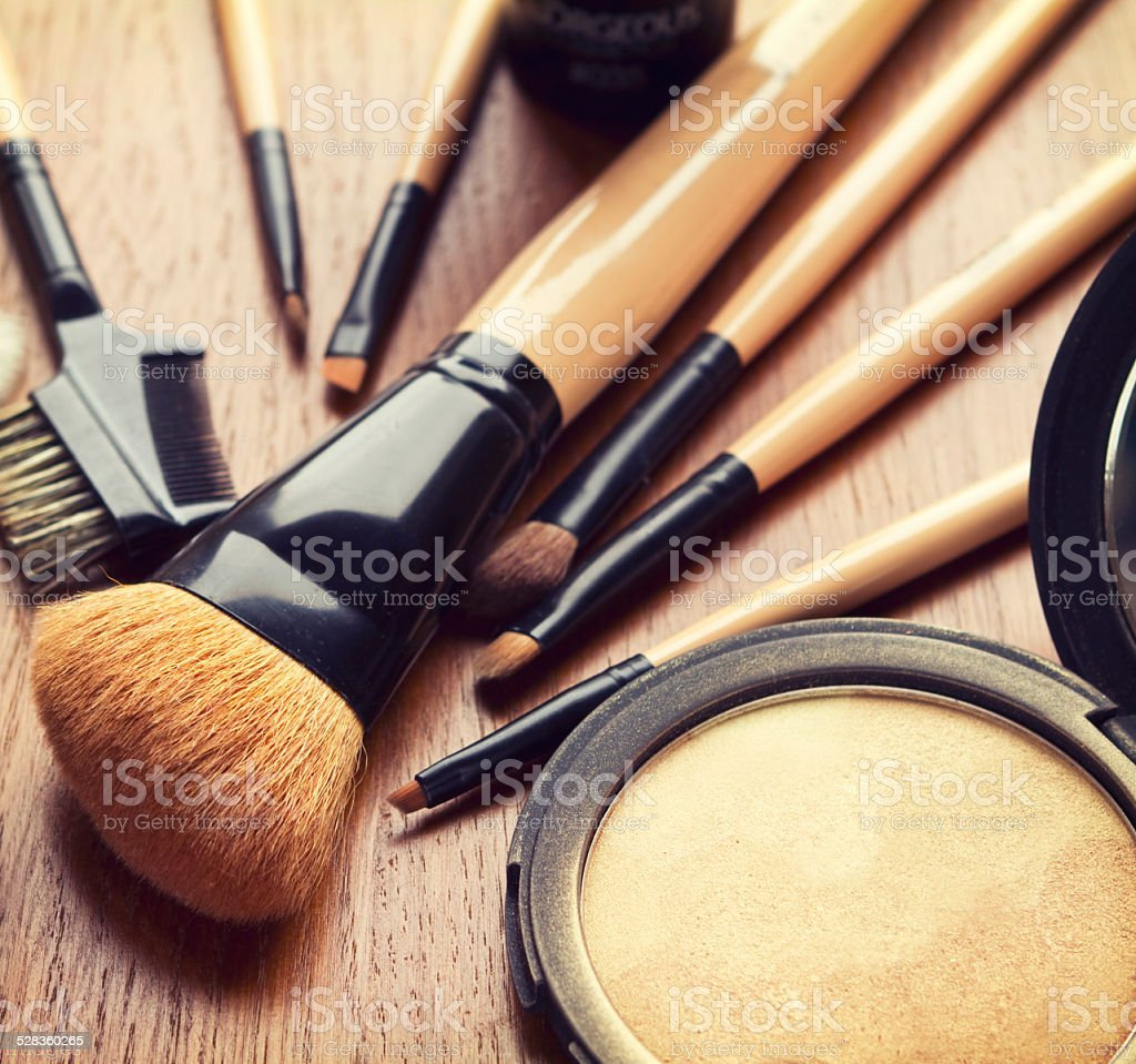 Set of makeup brushes and bronzer highlighter powder stock photo