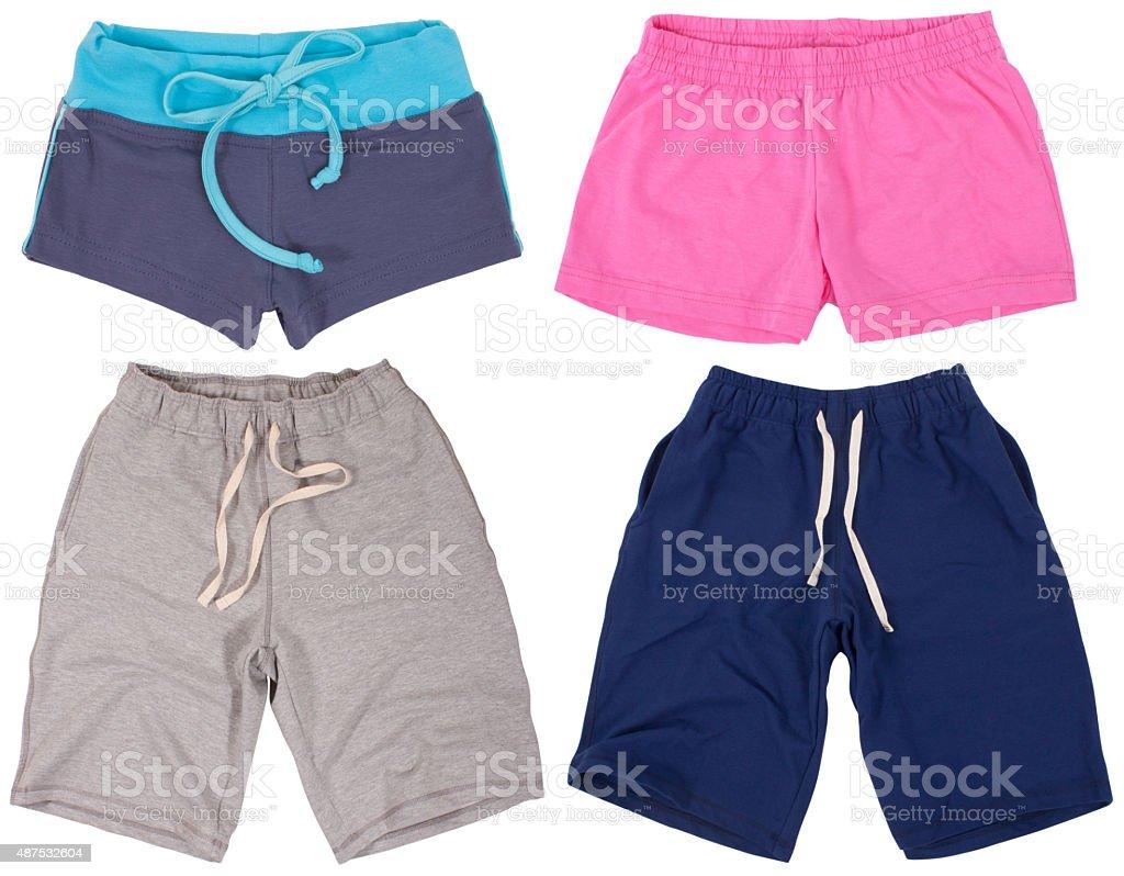 Set of male and female shorts. Isolated on white background stock photo