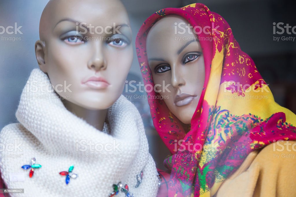 Set of Mannequins on a store window stock photo