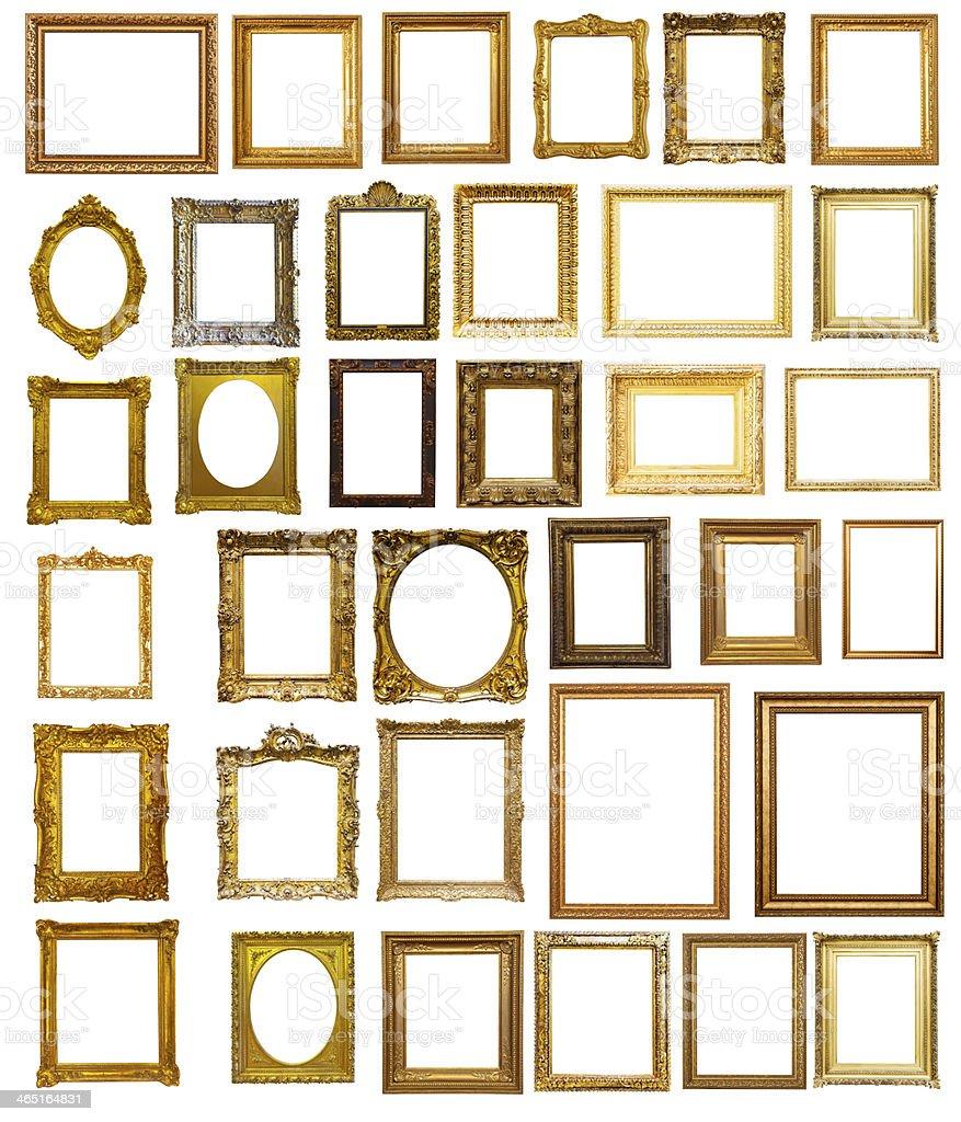 Set of many gilded frames. Isolated over white background stock photo