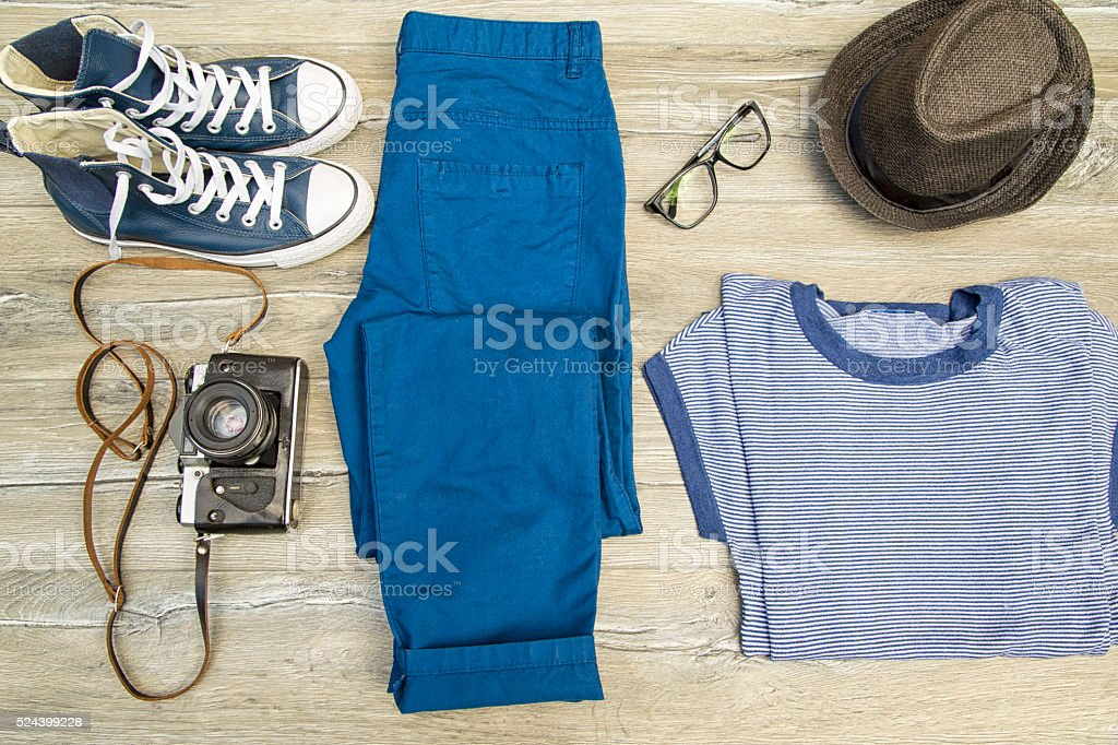 Set of men's clothing and accessories on wooden table. stock photo