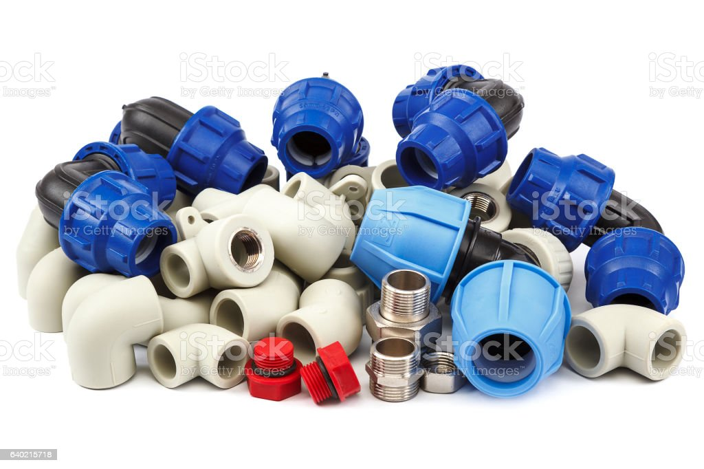 Set of metal-plastic plumbing couplings, adapters, plugs stock photo