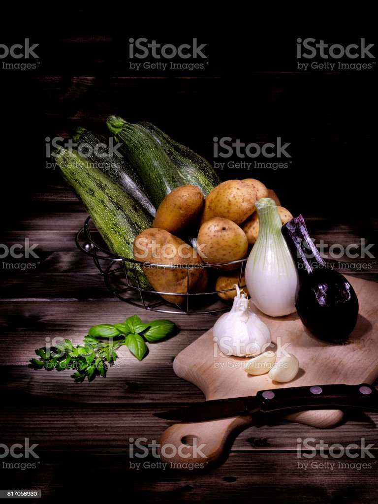 Set of mixed vegetables on aged wooden table stock photo