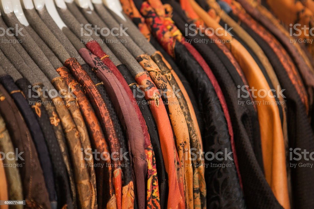 Set of moroccan bright colorful clothes at a market stock photo