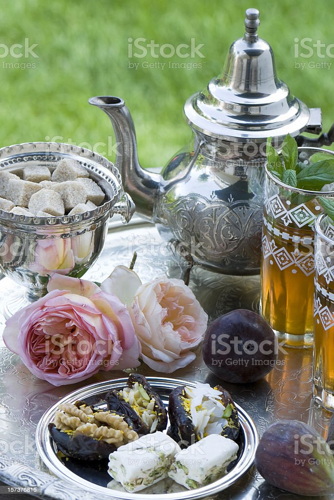 A set of Moroccan tea with finger food and flowers stock photo