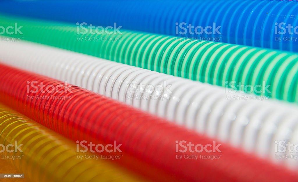 Set of multicolored corrugated hoses stock photo