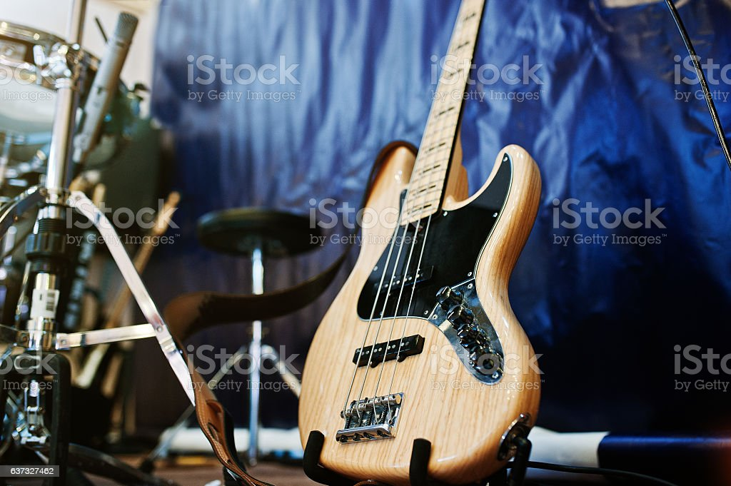 Set of musical instruments. Bass guitar and drums stock photo