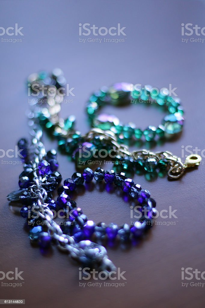 Set of necklaces with bracelets in glass stock photo