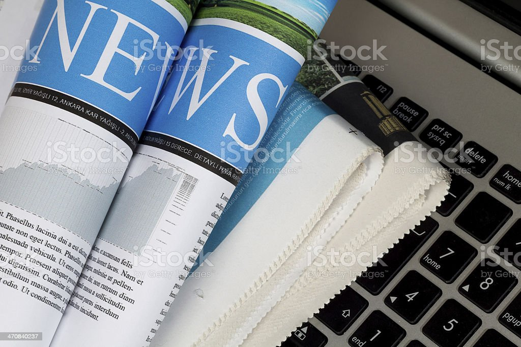 Set of newspapers on the keyboard stock photo