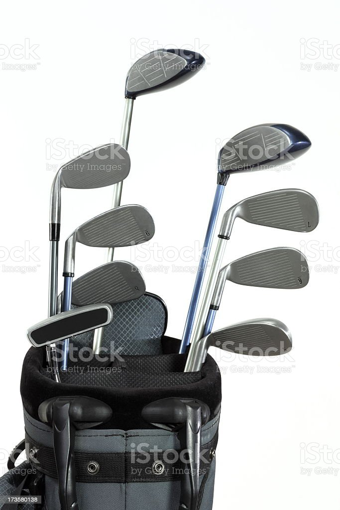 A set of nine golf clubs in a bag on a white background stock photo