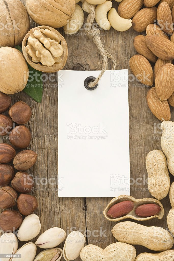 set of nuts fruit and tag label on wood royalty-free stock photo