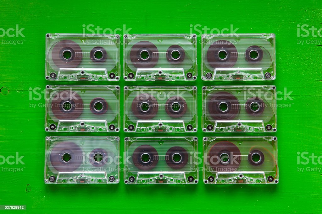Set of old audio cassettes on wooden table. stock photo