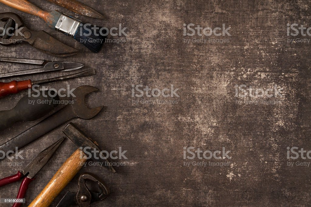 Set of Old Tools on Rustic Background stock photo