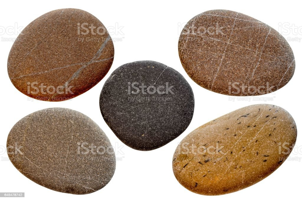 set of oval stones isolated on a white background stock photo
