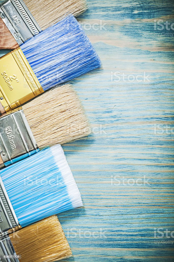 Set of paint brushes on wood board construction concept stock photo