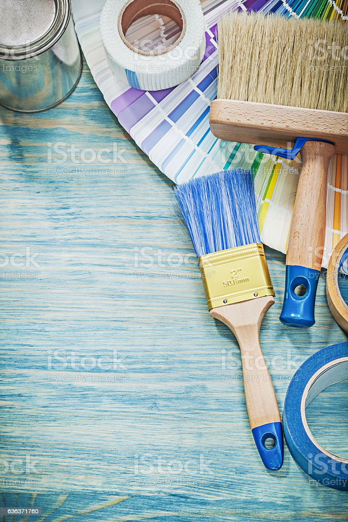 Set of paint cans brushes color sampler adhesive tape on stock photo