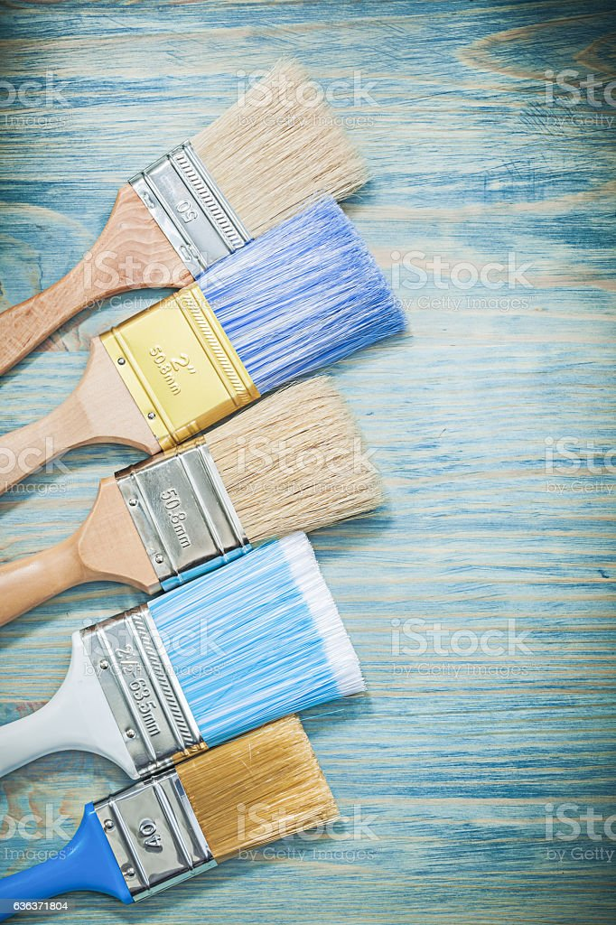 Set of paintbrushes on wooden board construction concept stock photo