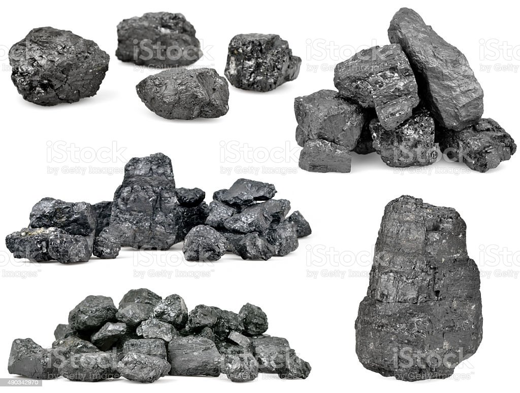 Set of piles of coal isolated on white stock photo