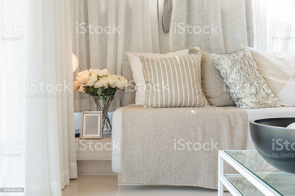 set of pillows on grey sofa in modern living room stock photo