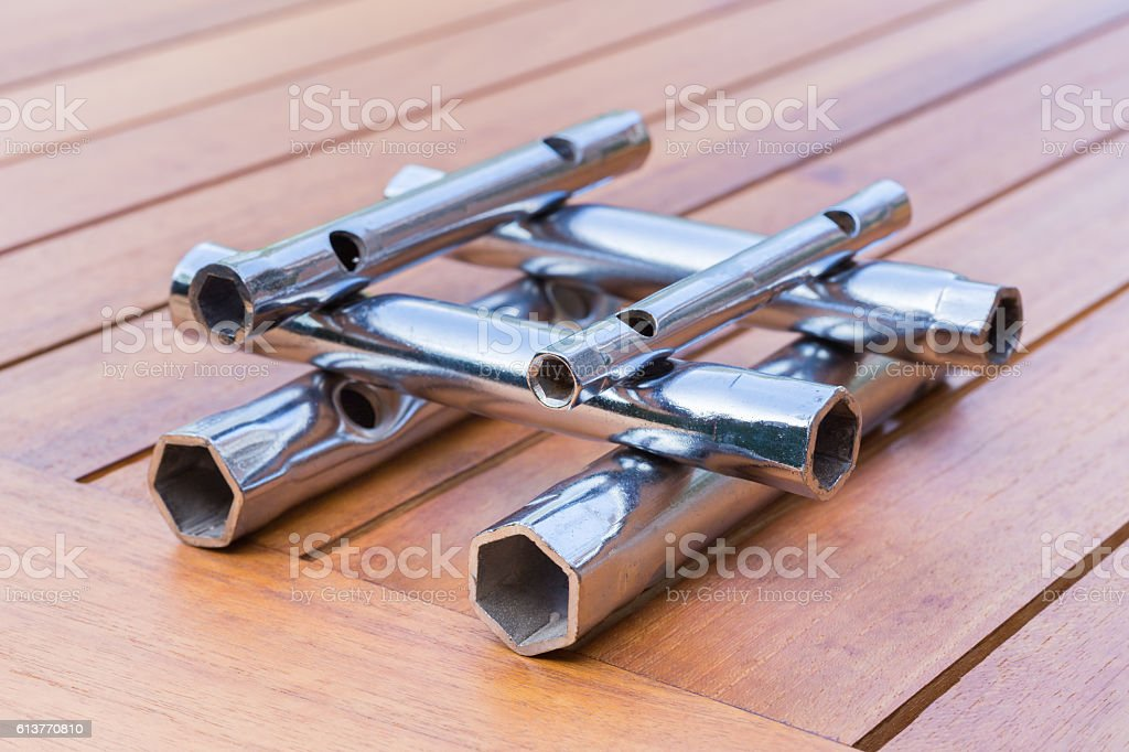 Set of pipe wrenches as construction on table stock photo