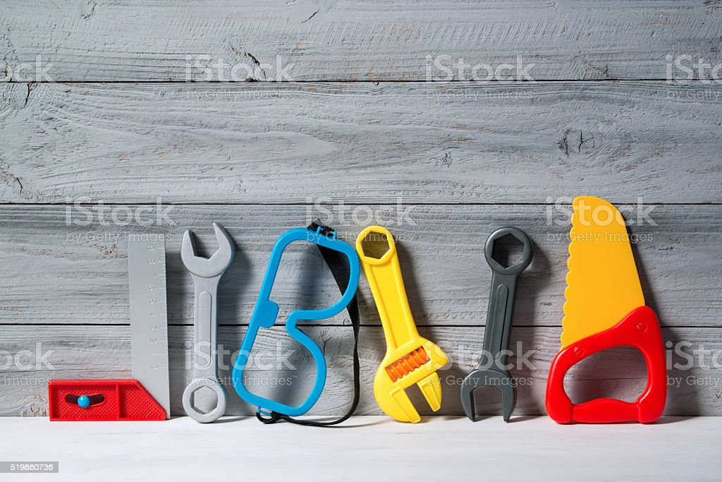 Set of plastic toy tools for children on a background stock photo