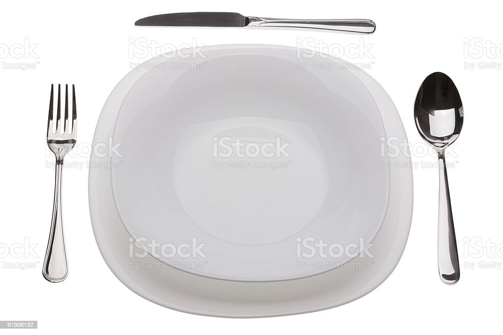 Set of plates with tablewares royalty-free stock photo