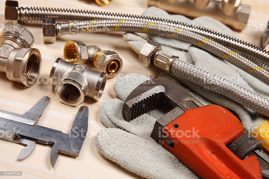 Set of plumbing and tools on the table stock photo