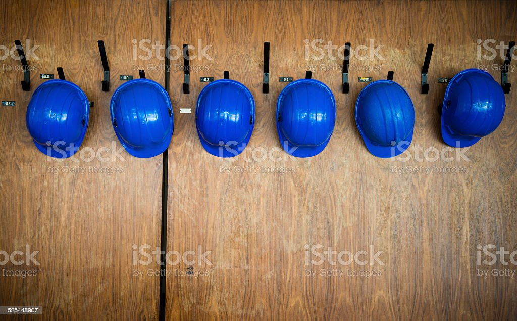 set of protective helmets hanging on the hanger stock photo