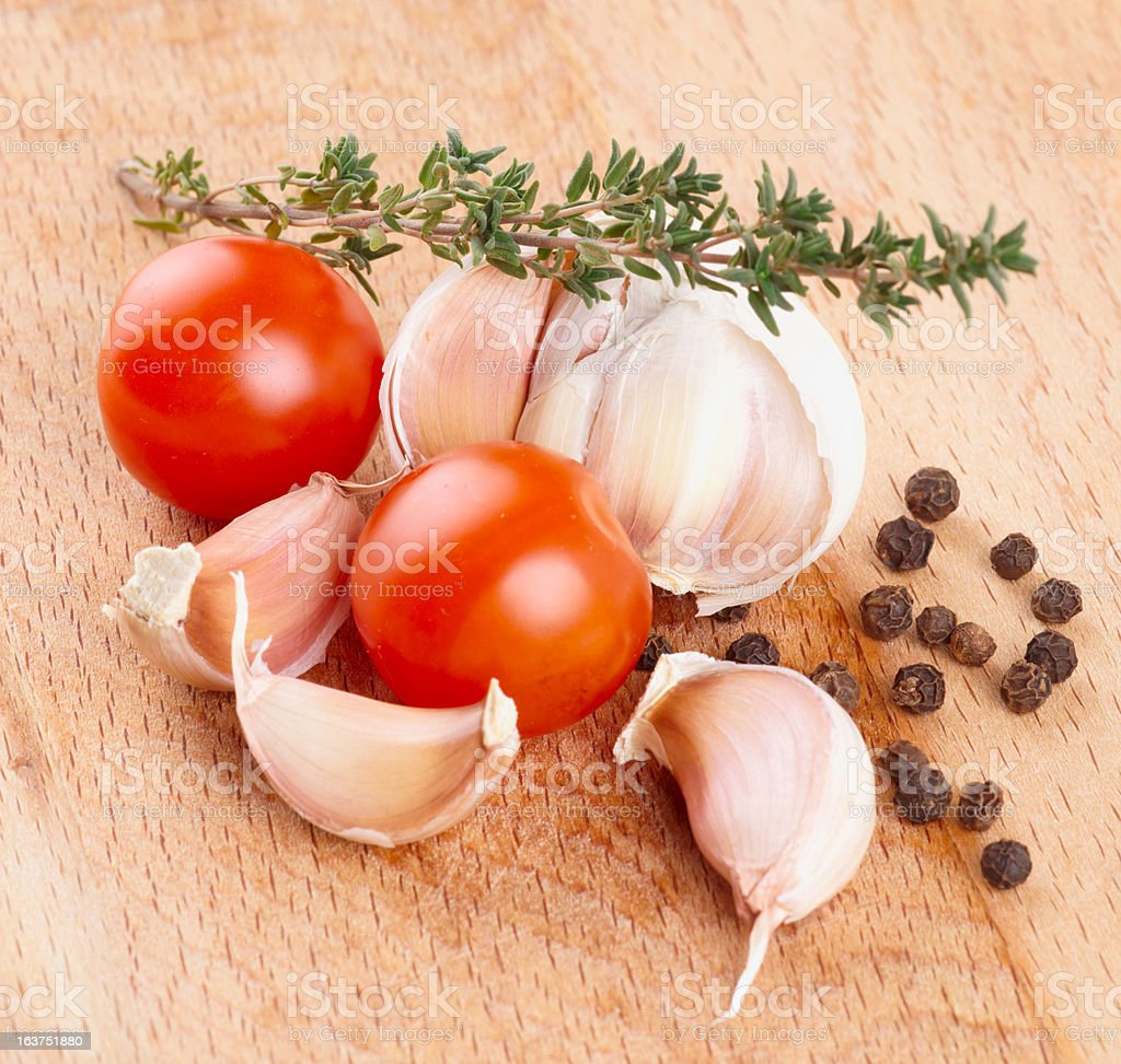 Set of raw ingredients on wooden plank royalty-free stock photo