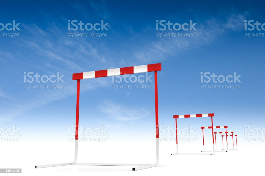 A set of red and white running hurdles stock photo
