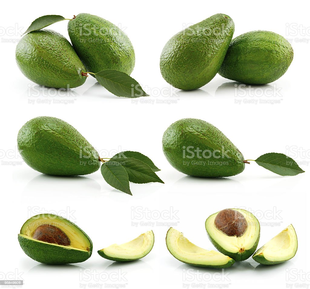 Set of Ripe Sliced Avocado Fruits Isolated on White royalty-free stock photo