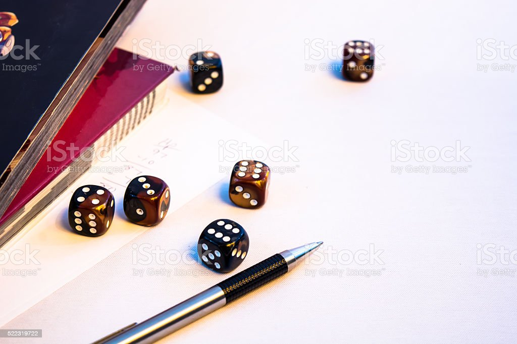 Set of Roleplaying dice on a book stock photo