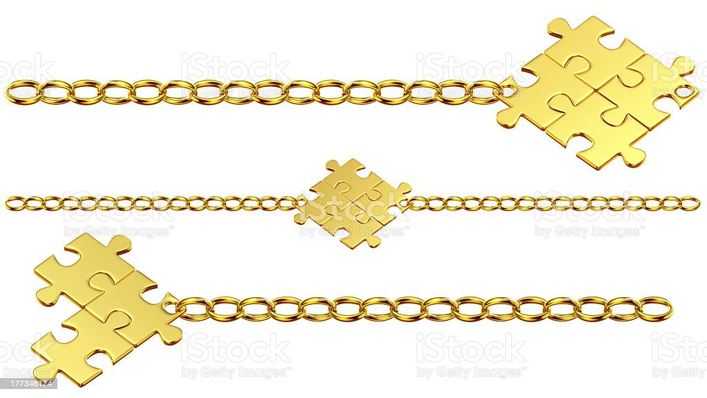 Set of shiny gold chains with puzzles royalty-free stock photo