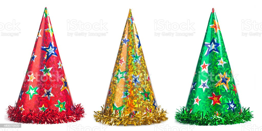 Set of shiny party hats on white background stock photo