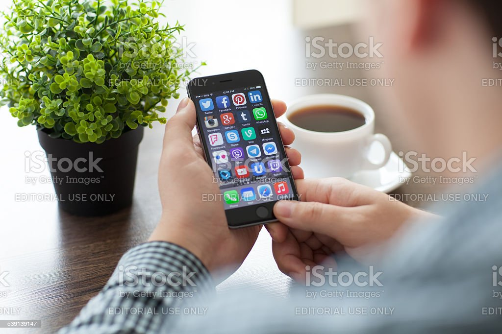 Set of social networking on iPhone 6 in man hands stock photo