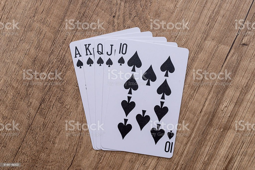 Set of Spade suit playing cards on wooden desk stock photo