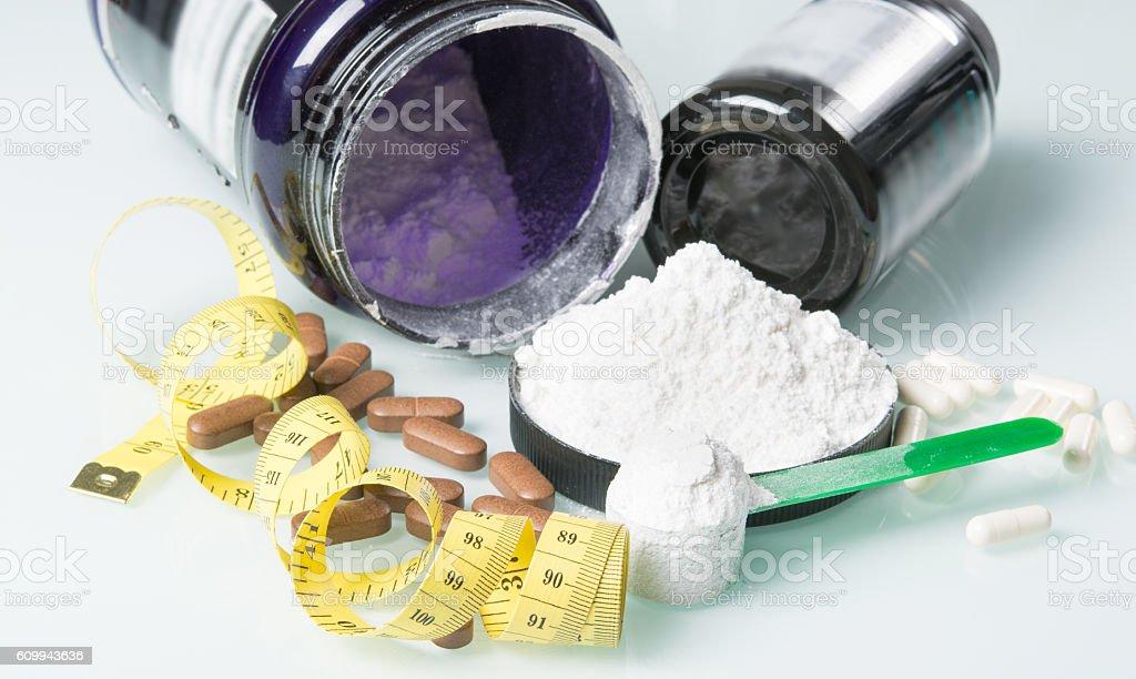 set of sports nutrition a white powder stock photo