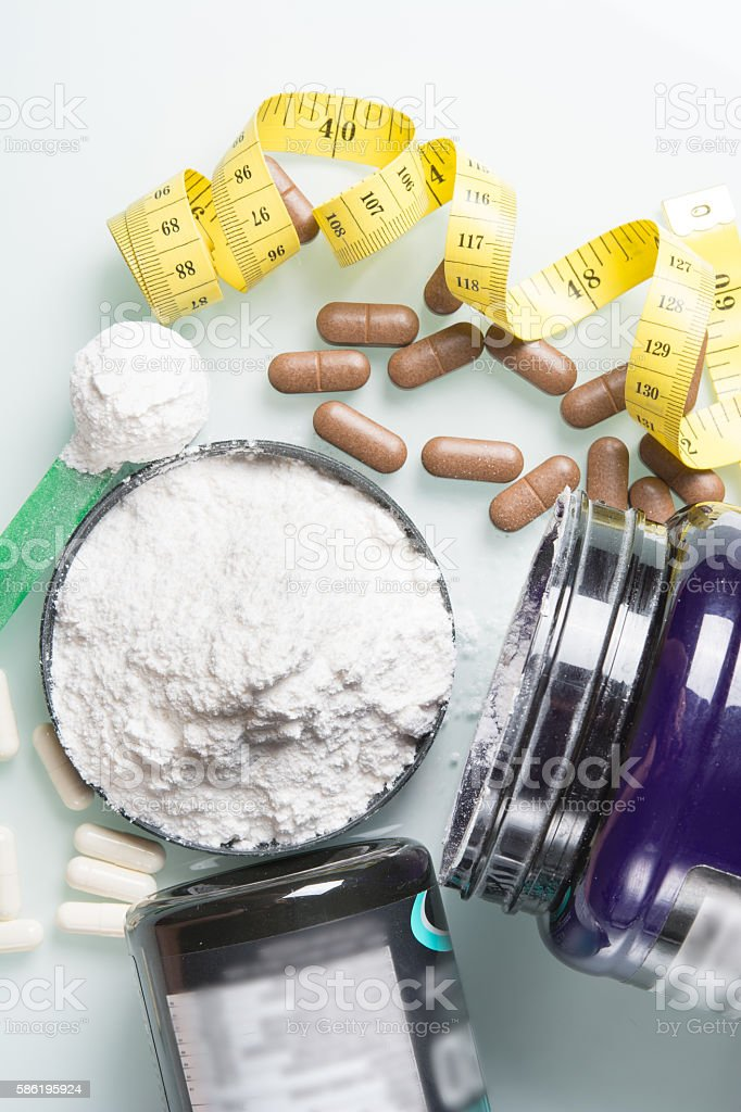 set of sports nutrition with capsules stock photo