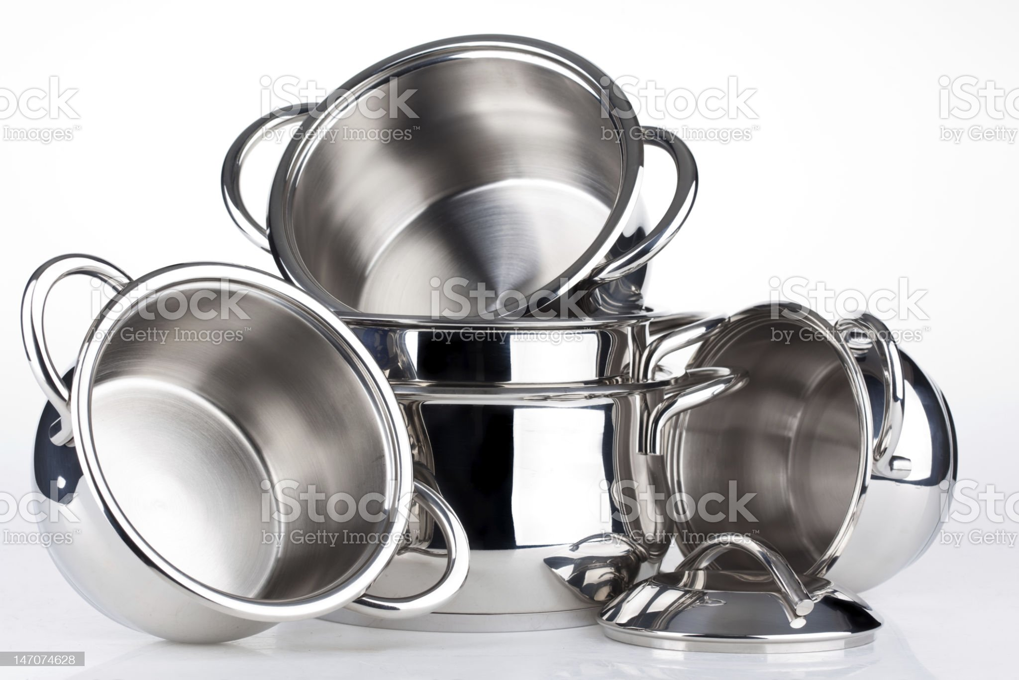 A set of stainless steel pots and lids  royalty-free stock photo