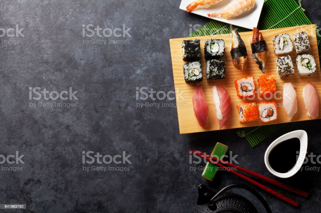 Set of sushi, maki and green tea stock photo