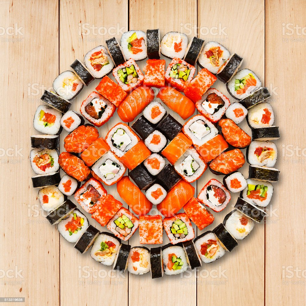 Set of sushi, maki and rolls isolated at wood stock photo