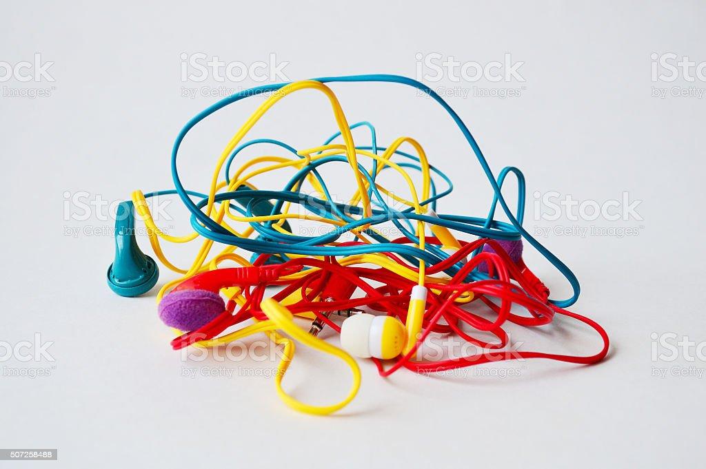 Set of tangled colourful head-phones stock photo