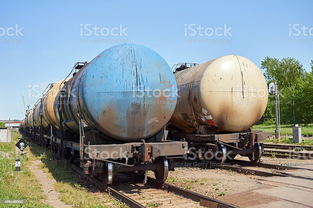 Set of tanks with oil and fuel transport by rail stock photo