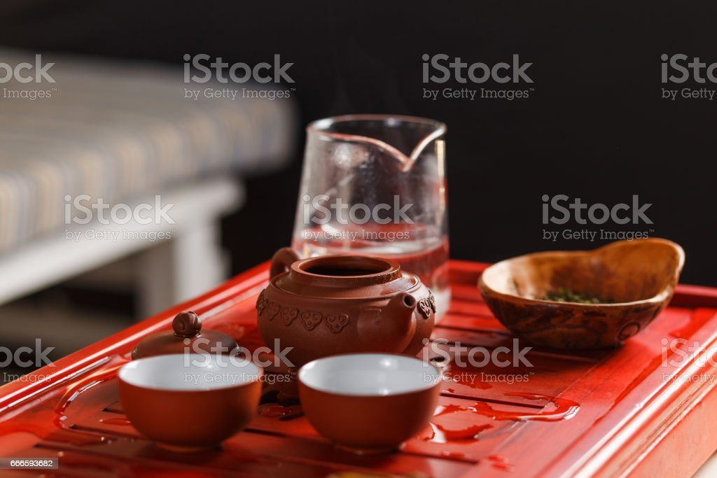 Set of teapot, chahe with tea and two bowls stock photo