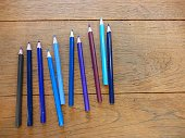 Set of the blue color pencil on the wood table