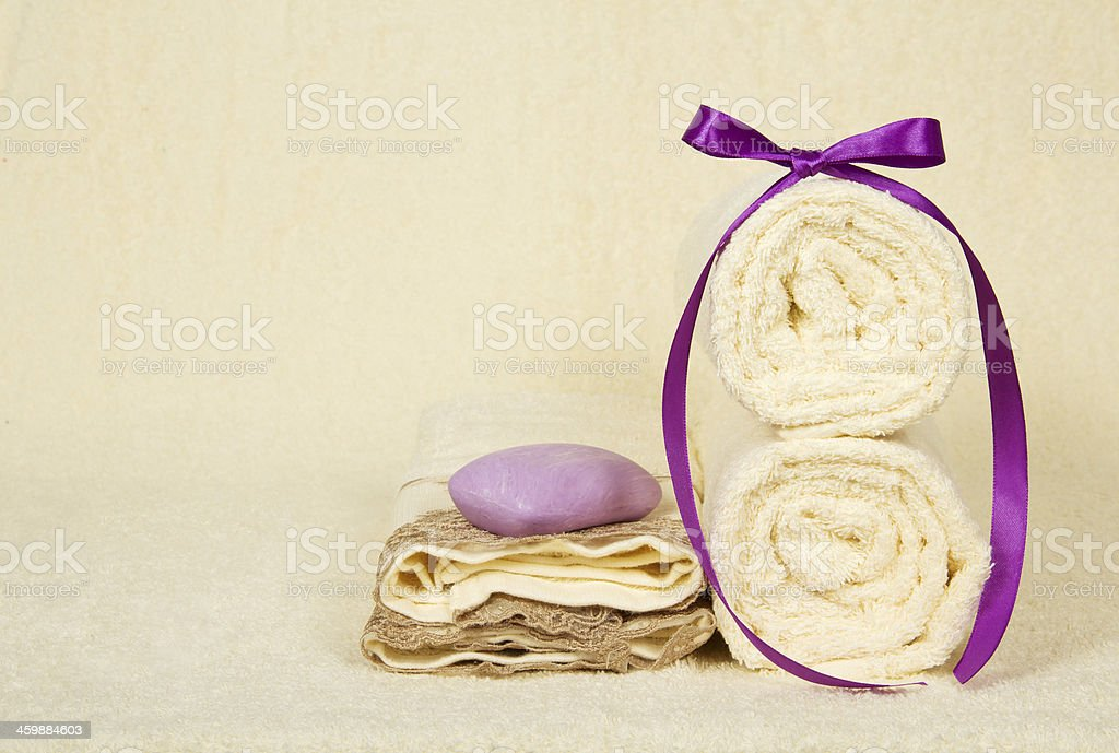 Set of the towels and soap on a terry cloth stock photo