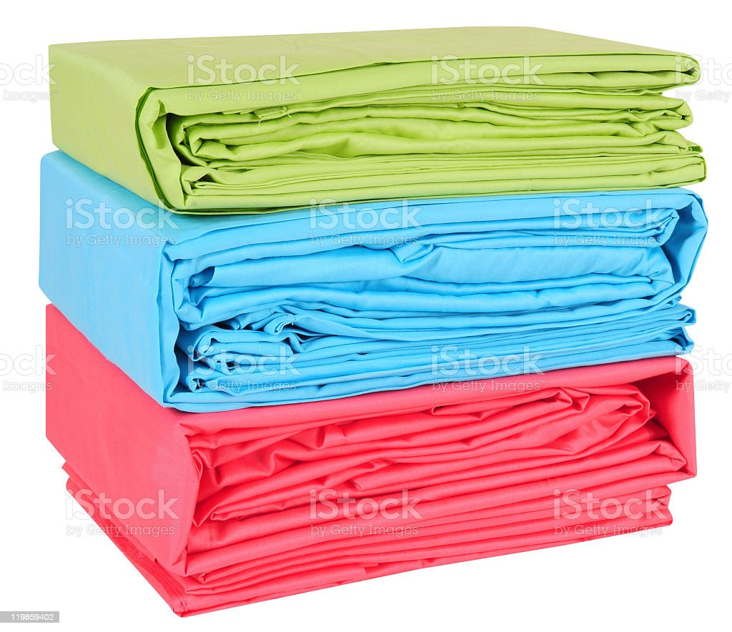 Set of three brightly colored bed sheets stock photo