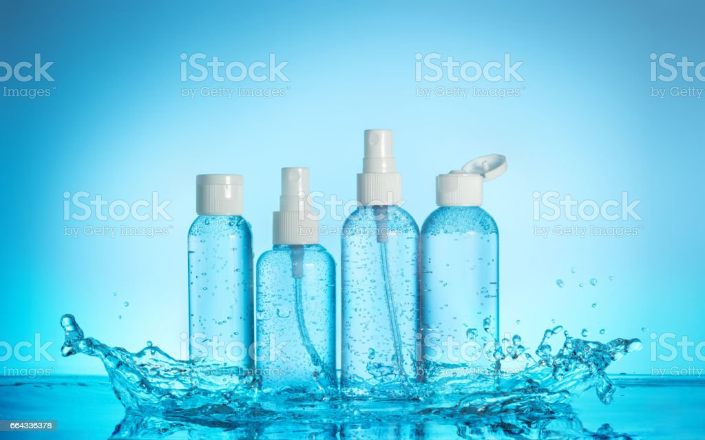 set of toiletries in a water splash stock photo