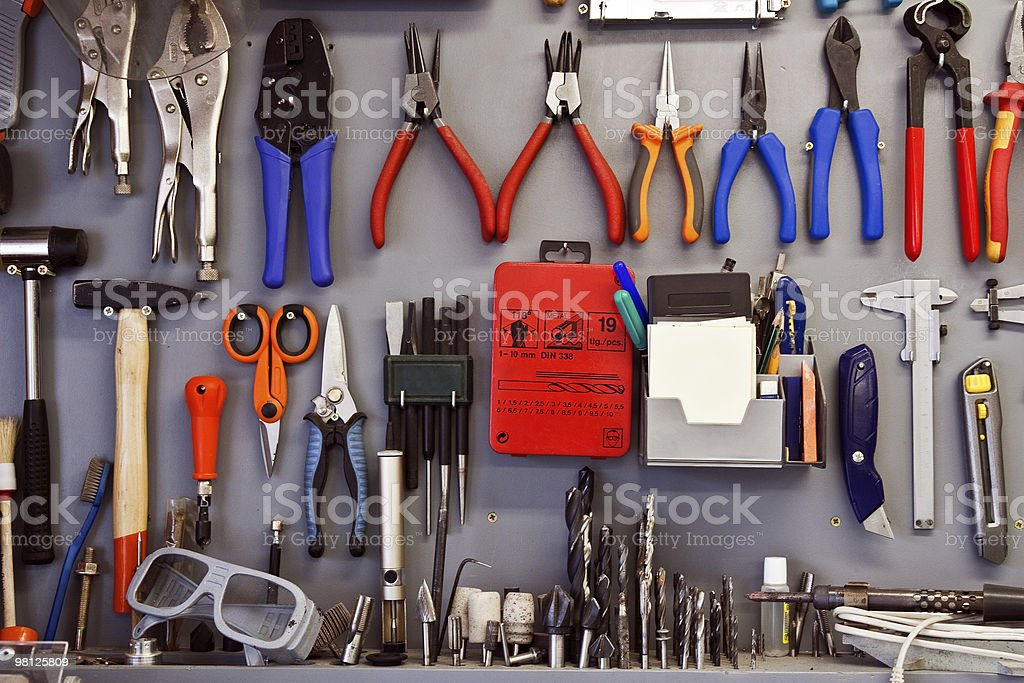 Set of tools hanging on a wall stock photo